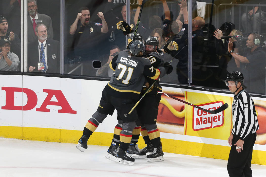 Vegas Golden Knights right wing Reilly Smith (19) celebrates his score with center William Karlsson (71) against Winnipeg Jets during the third period in Game 4 of the Western Conference Final at ...