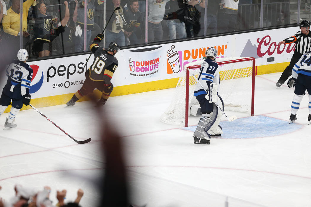 Vegas Golden Knights right wing Reilly Smith (19) celebrates his score against Winnipeg Jets goaltender Connor Hellebuyck (37) during the third period in Game 4 of the Western Conference Final at ...