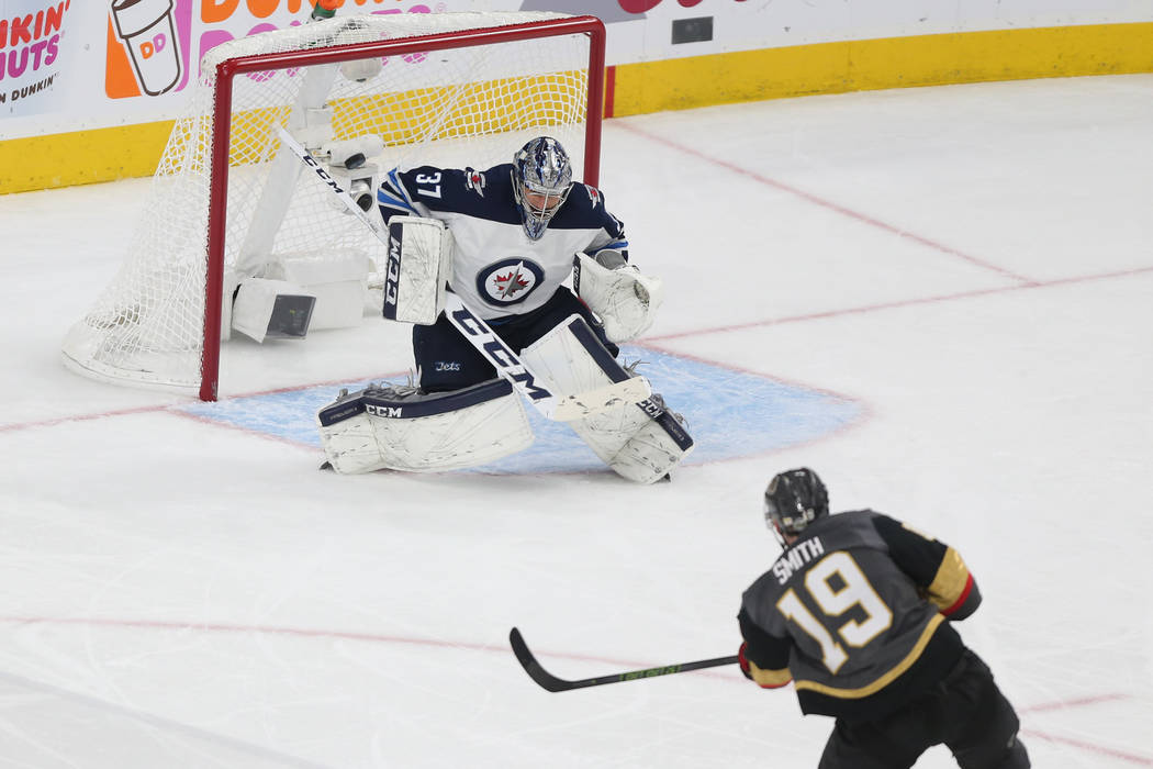Vegas Golden Knights right wing Reilly Smith (19) scores the game winning goal against Winnipeg Jets goaltender Connor Hellebuyck (37) during the third period in Game 4 of the Western Conference F ...