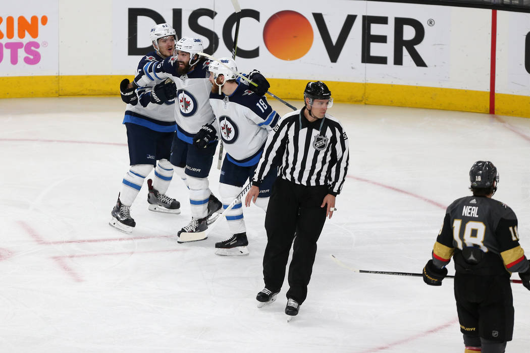 Winnipeg Jets center Jack Roslovic (52), center Mathieu Perreault (85) and center Bryan Little (18) celebrate a score during the third period in Game 4 of the Western Conference Final at T-Mobile ...