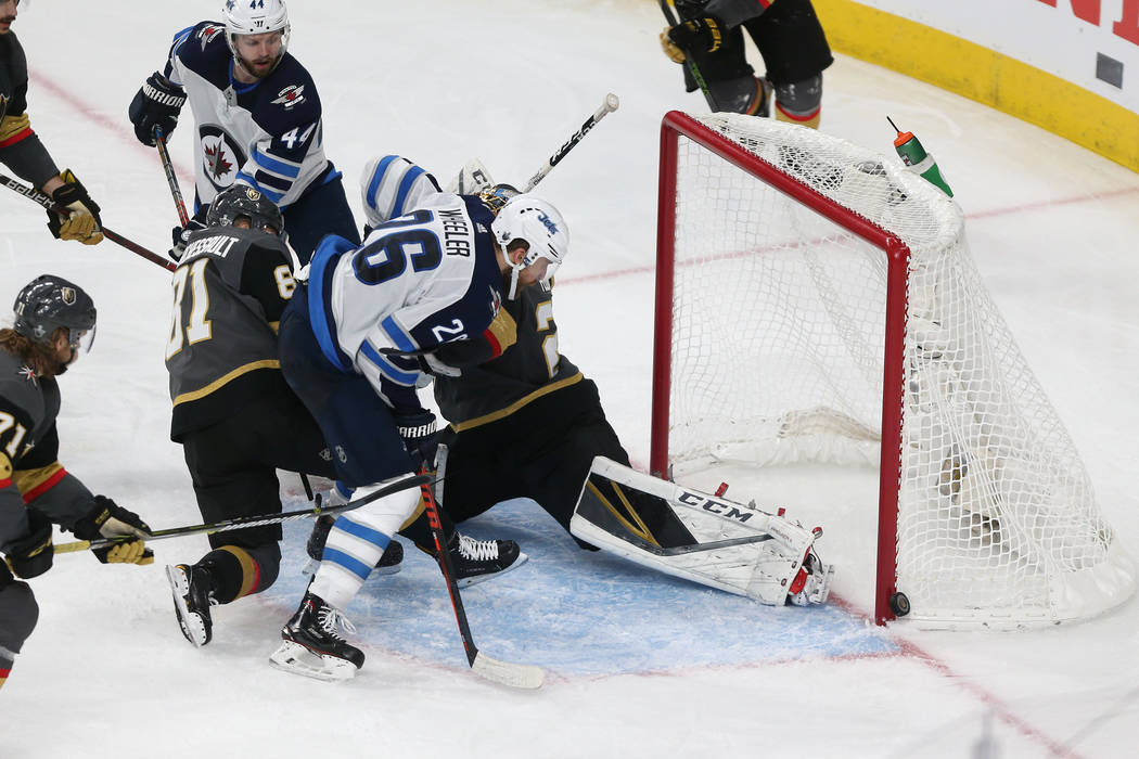 Winnipeg Jets right wing Blake Wheeler (26) misses a goal opportunity against Vegas Golden Knights during the third period in Game 4 of the Western Conference Final at T-Mobile Arena in Las Vegas, ...