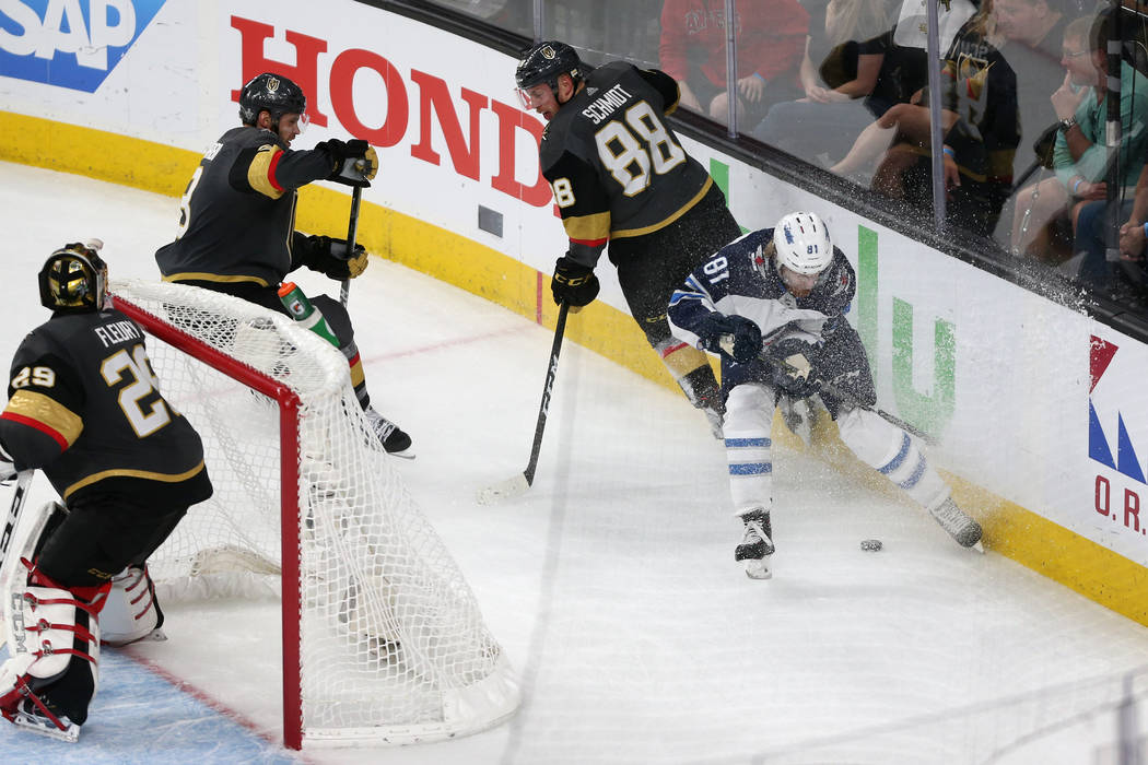 Vegas Golden Knights defenseman Nate Schmidt (88) defends against Winnipeg Jets left wing Kyle Connor (81) during the third period in Game 4 of the Western Conference Final at T-Mobile Arena in La ...