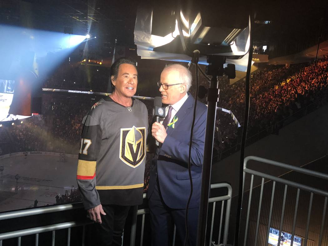 "Wayne Newton is shown being interviewed by CBC's ""Hockey Night in Canada"" host Scott Oake at T-Mobile Arena prior to the Vegas Golden Knights-Winnipeg Jets Western Conference Finals Stanley Cup Pl ..."