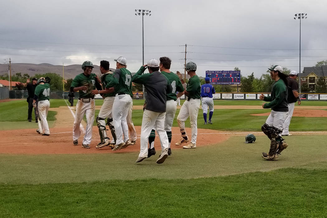 Palo Verde players congratulate Karsonne Winters after he scored a run against Reno in the fifth inning of the Class 4A state baseball tournament on Friday, May 18, 2018 at Reno High. Palo Verde w ...