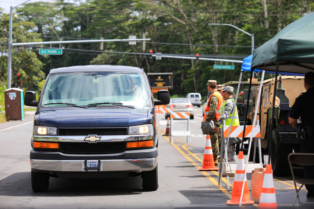 A Hawaii Air National Guard checkpoint ensures only locals are allowed into the area affected by the Kilauea eruptions near Leilani Estates, Hawaii, on Friday, May 18, 2018. Brett LeBlanc Las Vega ...
