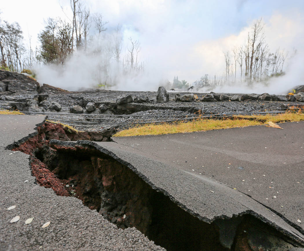 A road is torn apart by the Kilauea eruptions in Leilani Estates, Hawaii, on Friday, May 18, 2018. Brett LeBlanc Las Vegas Review-Journal