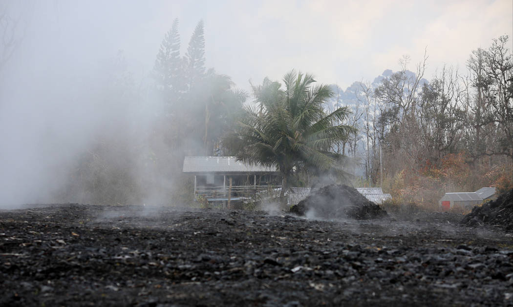 A steaming field obscures a house in Leilani Estates, Hawaii, which is being affected by Kilauea eruptions on Friday, May 18, 2018. Brett LeBlanc Las Vegas Review-Journal