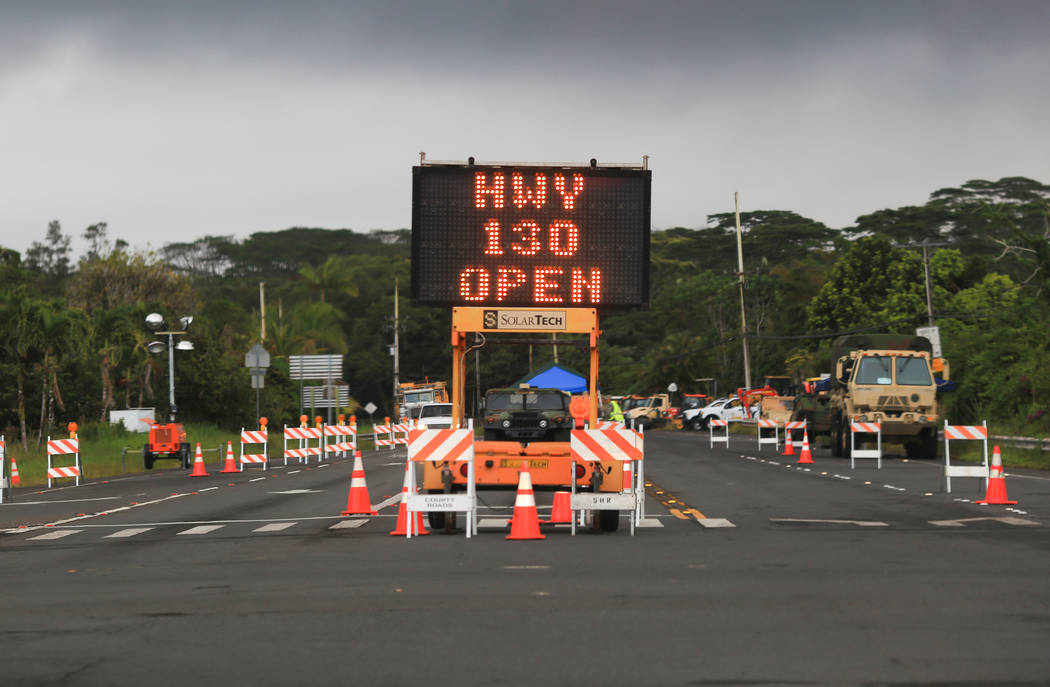 A sign at a Hawaii National Guard checkpoint tells residents Highway 130, which weaves through the affected area of the Kilauea eruptions, remains open near Leilani Estates, Hawaii, on Thursday, M ...
