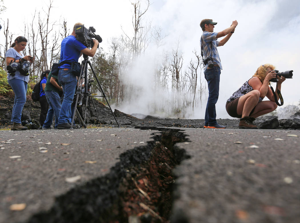Journalists take photos of an area affected by the Kilauea eruptions in Leilani Estates, Hawaii, on Friday, May 18, 2018. Brett LeBlanc Las Vegas Review-Journal
