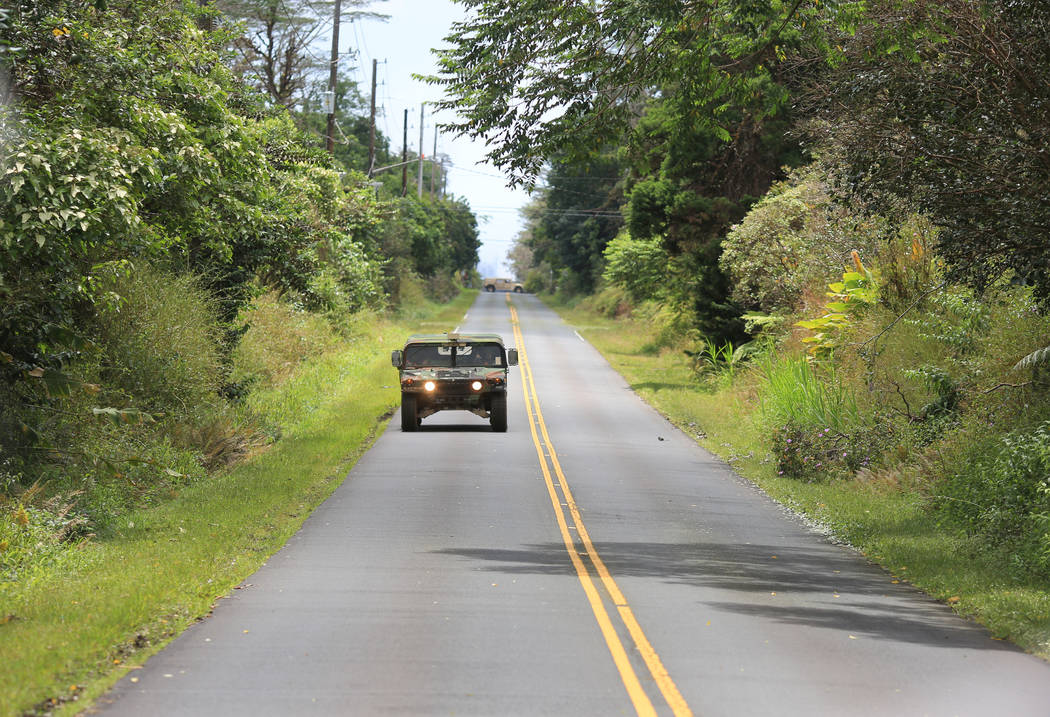 National Guard Humvees patrol roads in Leilani Estates, Hawaii, which is at risk from both the Kilauea eruptions and looters on Friday, May 18, 2018. Brett LeBlanc Las Vegas Review-Journal