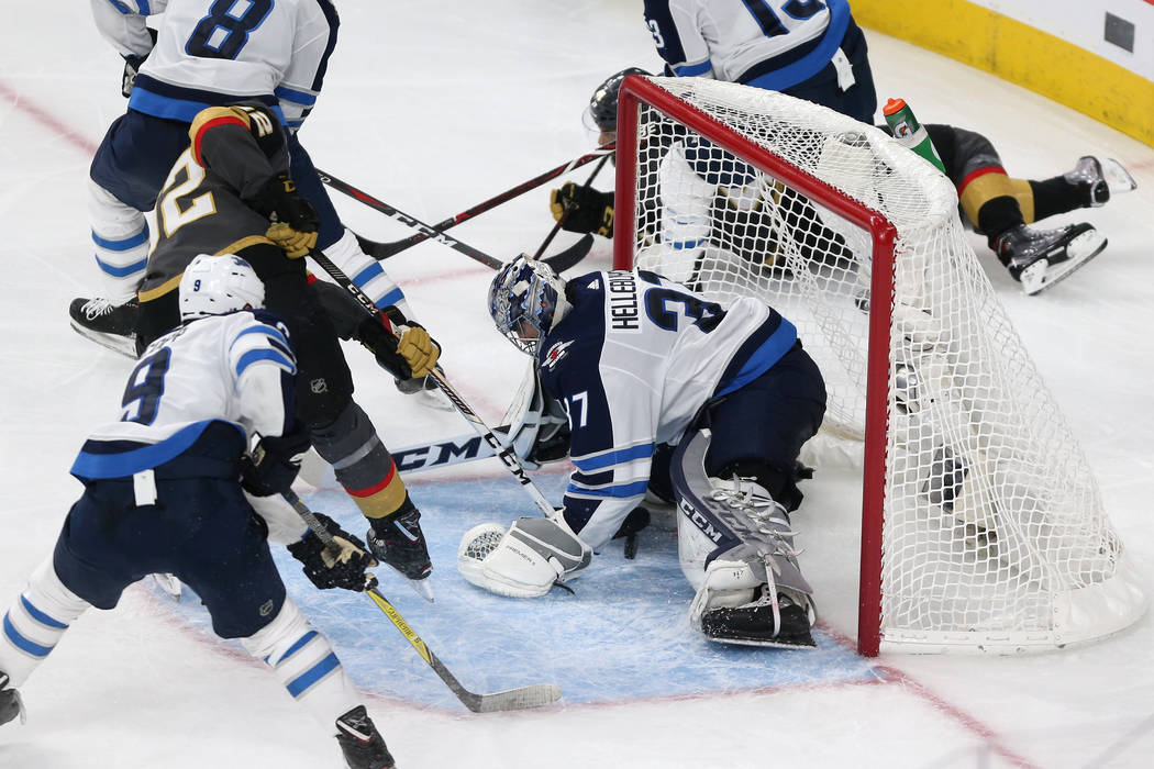 Vegas Golden Knights left wing Tomas Nosek (92) shoots for a score against Winnipeg Jets goaltender Connor Hellebuyck (37) during the second period in Game 4 of the Western Conference Final at T-M ...