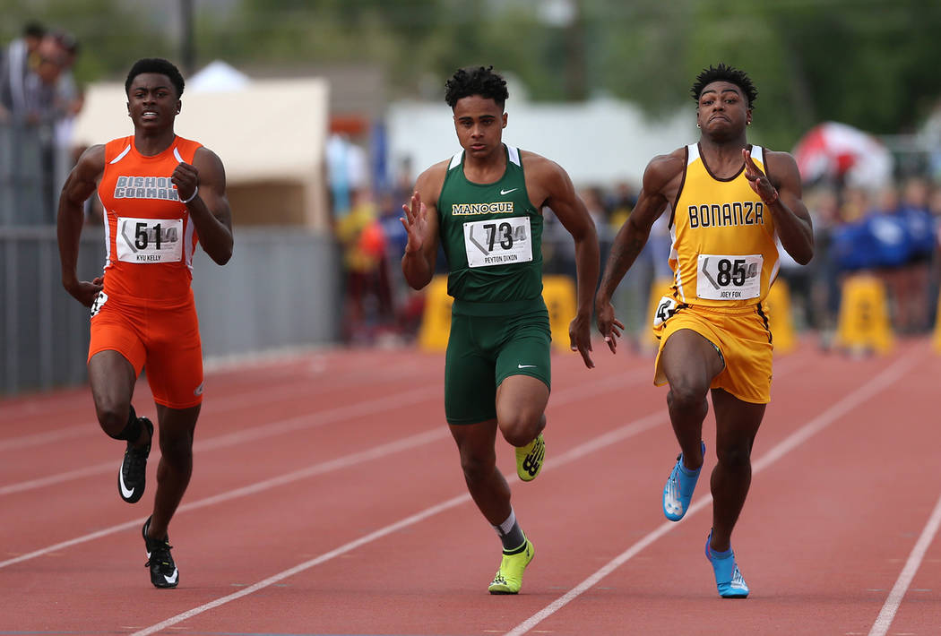 From left, Bishop Gormanճ Kyu Kelly, Bishop Manogueճ Peyton Dixon and Bonanzaճ Joey Fox compete in the 4A 100-meter dash the NIAA Track & Field Championships at Carson High i ...