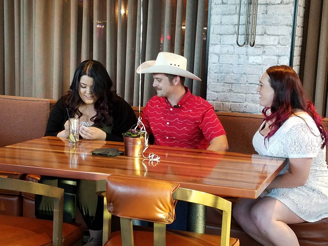 Oct. 1 mass shooting survivor Taylor Stovall, 18, (left), meets with Parker Gabel, 26, (center) and his wife, Sarah. Stovall and Gabel were meeting for the first time since Gabel helped the injure ...