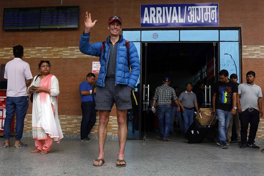 Australian climber Steve Plain waves as he arrives at Kathmandu airport, Nepal, Saturday, May 19, 2018. (Niranjan Shrestha/AP)