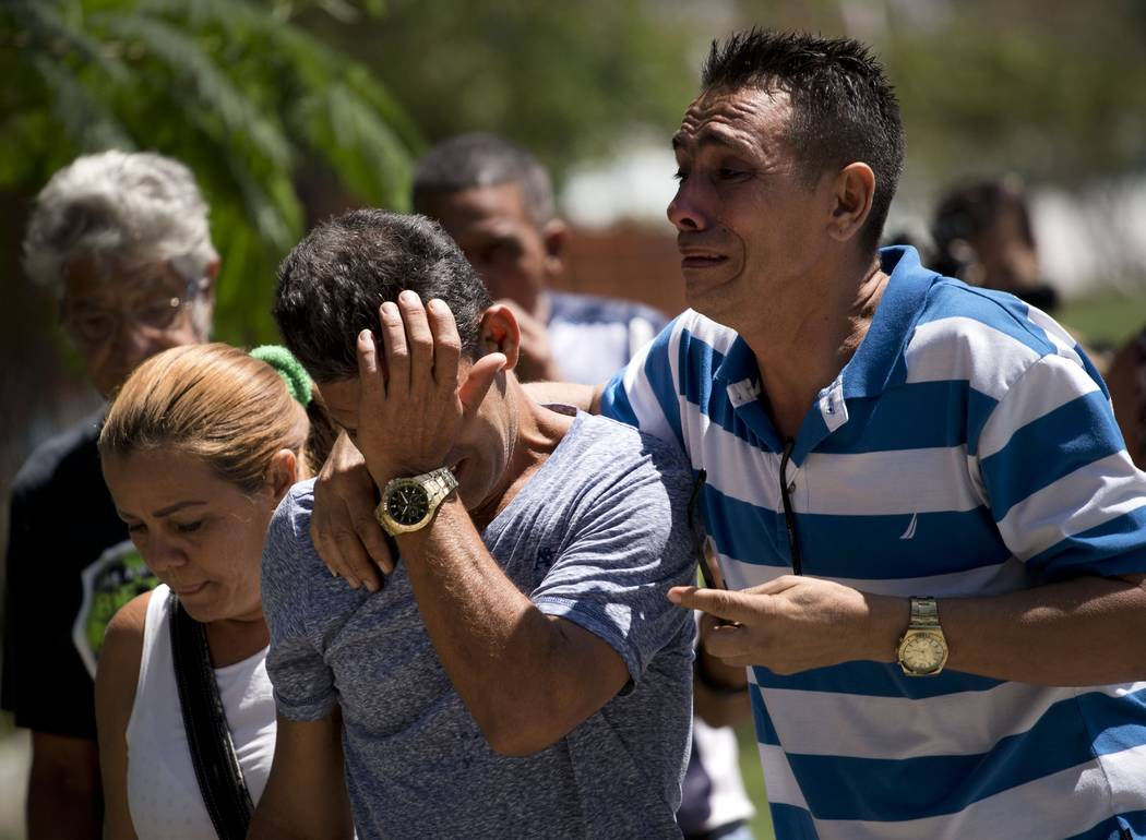 Grieving relatives of passengers who perished in Cuba's worst aviation disaster arrive to the morgue, in Havana, Cuba, Saturday, May 19, 2018. Investigators are trying to determine why an aging Bo ...