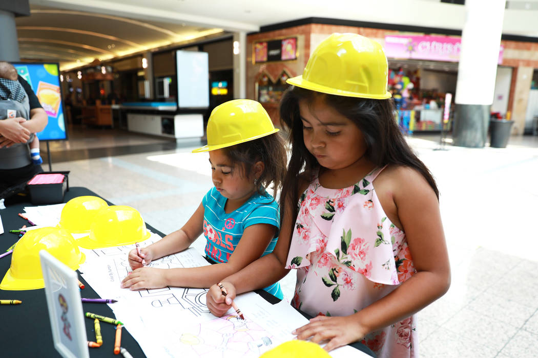 Nicole Montesdeoca, 6, left, and her sister Kimberly, 8, color during the Reading Rangers Summer Reading Program at Boulevard Mall in Las Vegas on Saturday, May 19, 2018. Students were given the o ...