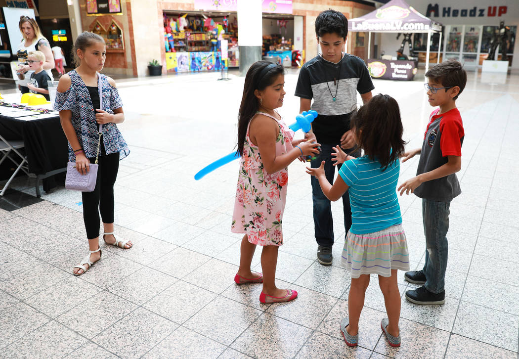 Students play a game of hot potato during the Reading Rangers Summer Reading Program at Boulevard Mall in Las Vegas on Saturday, May 19, 2018. Students were given the opportunity to meet Reading R ...