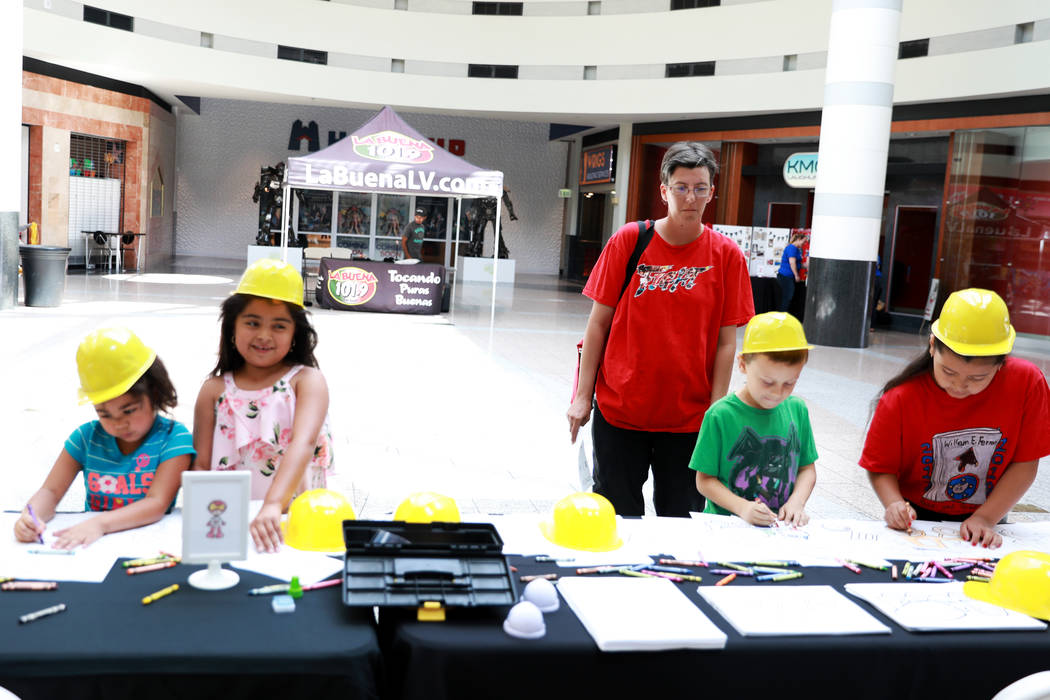 Families attend the Reading Rangers Summer Reading Program at Boulevard Mall in Las Vegas on Saturday, May 19, 2018. Students were given the opportunity to meet Reading Rangers superhero character ...