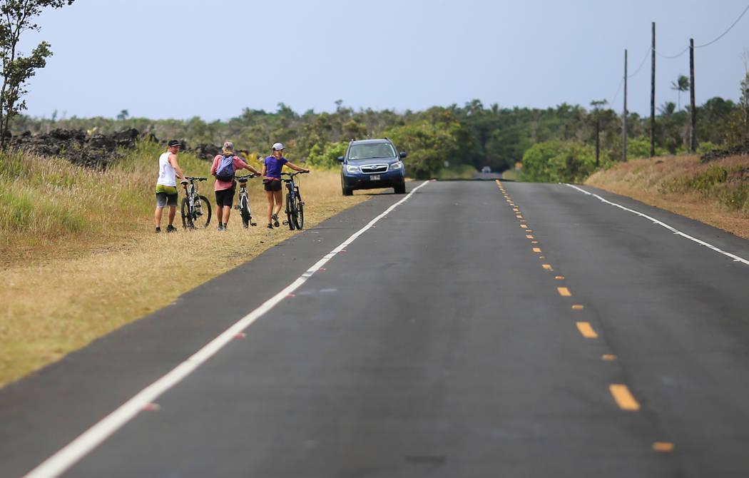 Bikers walk along Kapoho Road near Leilani Estates, Hawaii, where the Kilauea eruptions continues on Saturday, May 19, 2018. Brett LeBlanc Las Vegas Review-Journal