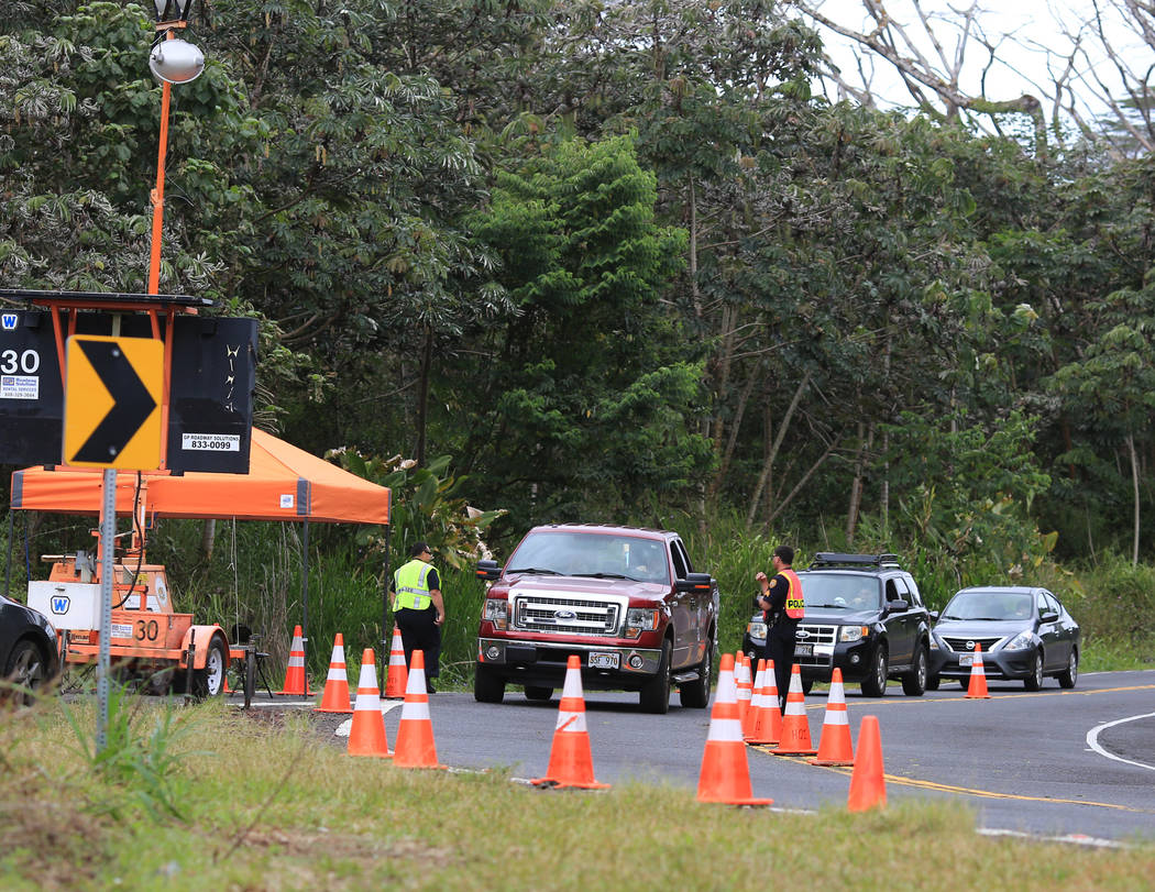 Police and National Guardsmen run a checkpoint into the area affected by the Kilauea eruptions in Leilani Estates, Hawaii, on Saturday, May 19, 2018. Brett LeBlanc Las Vegas Review-Journal