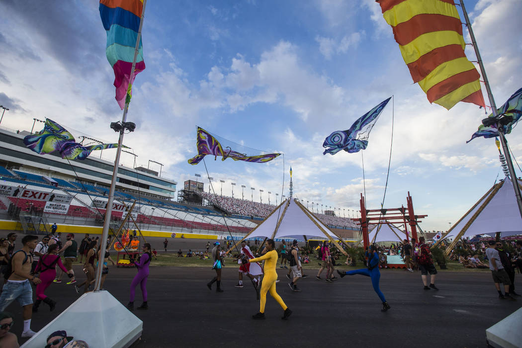 Costumed performers entertain arriving fans near the Cosmic Meadow stage during the second day of the Electric Daisy Carnival at the Las Vegas Motor Speedway in Las Vegas on Saturday, May 19, 2018 ...