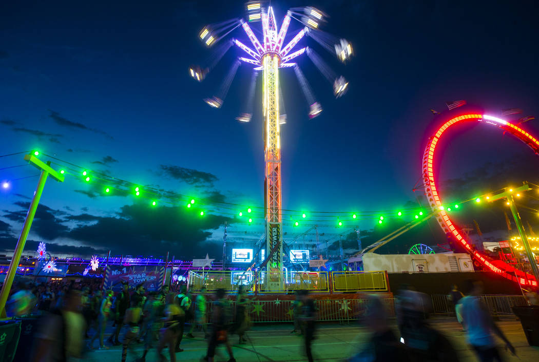 Carnival rides light up as attendees pass by during the second day of the Electric Daisy Carnival at the Las Vegas Motor Speedway in Las Vegas on Saturday, May 19, 2018. Chase Stevens Las Vegas Re ...