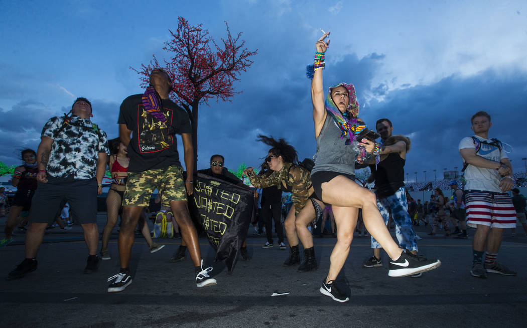 Attendees dance by an art car during the second day of the Electric Daisy Carnival at the Las Vegas Motor Speedway in Las Vegas on Saturday, May 19, 2018. Chase Stevens Las Vegas Review-Journal @c ...