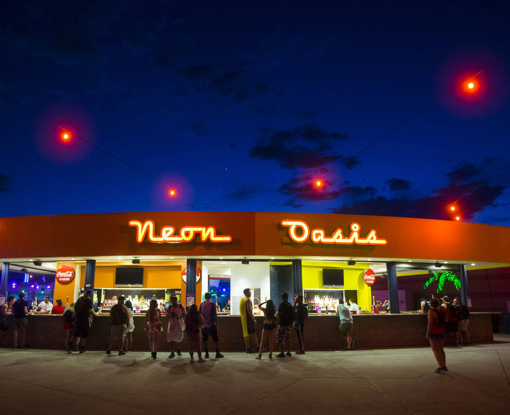 Attendees stop by the Neon Oasis bar at dusk during the second day of the Electric Daisy Carnival at the Las Vegas Motor Speedway in Las Vegas on Saturday, May 19, 2018. Chase Stevens Las Vegas Re ...