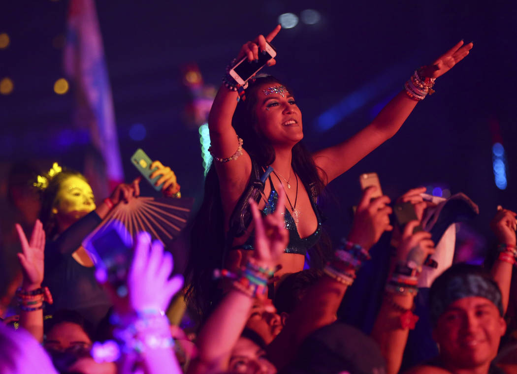 Attendees dance to Kygo at the Kinetic Field stage during the second day of the Electric Daisy Carnival at the Las Vegas Motor Speedway in Las Vegas on Saturday, May 19, 2018. Chase Stevens Las Ve ...