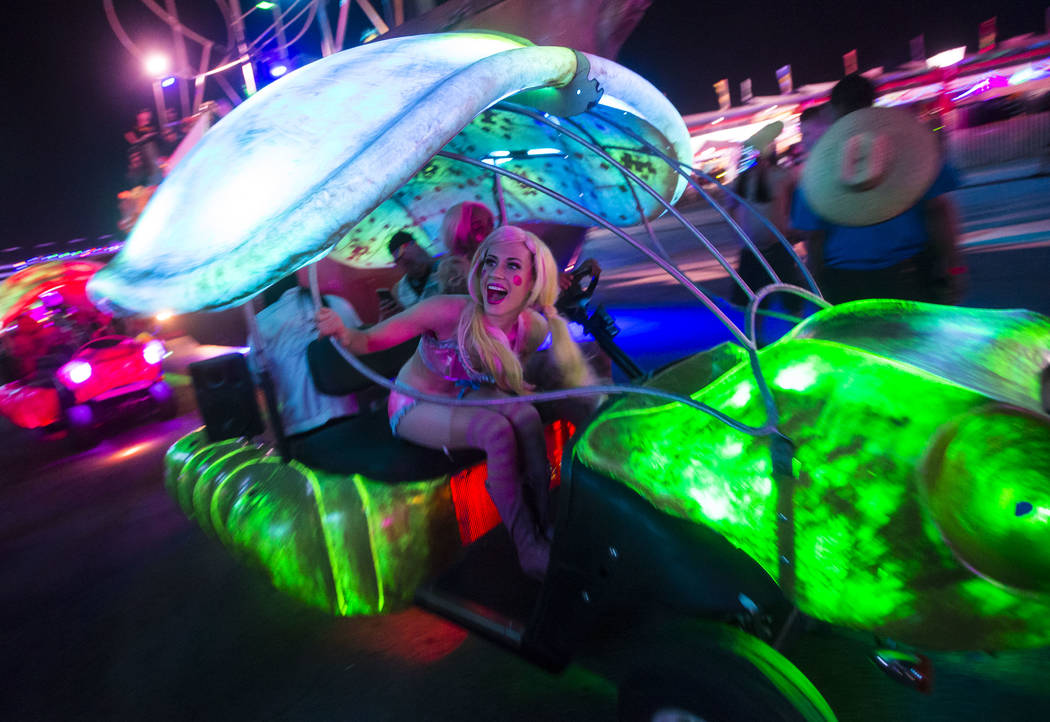 Attendees pass by in a small art car during the second day of the Electric Daisy Carnival at the Las Vegas Motor Speedway in Las Vegas on Saturday, May 19, 2018. Chase Stevens Las Vegas Review-Jou ...