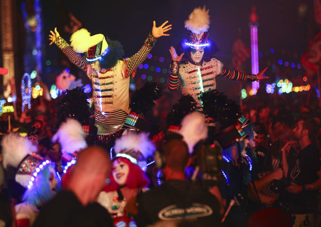 Marching Majorettes, a group of costumed performers, entertain attendees at the Kinetic Field stage during the second day of the Electric Daisy Carnival at the Las Vegas Motor Speedway in Las Vega ...