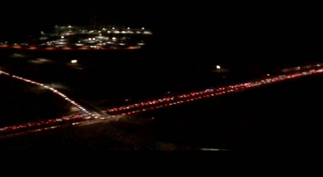 A look at a stream of taillights of cars trekking to Electric Daisy Carnival at Las Vegas Motor Speedway on Saturday, May 19, 2018. (John Katsilometes/Las Vegas Review-Journal). @JohnnyKats