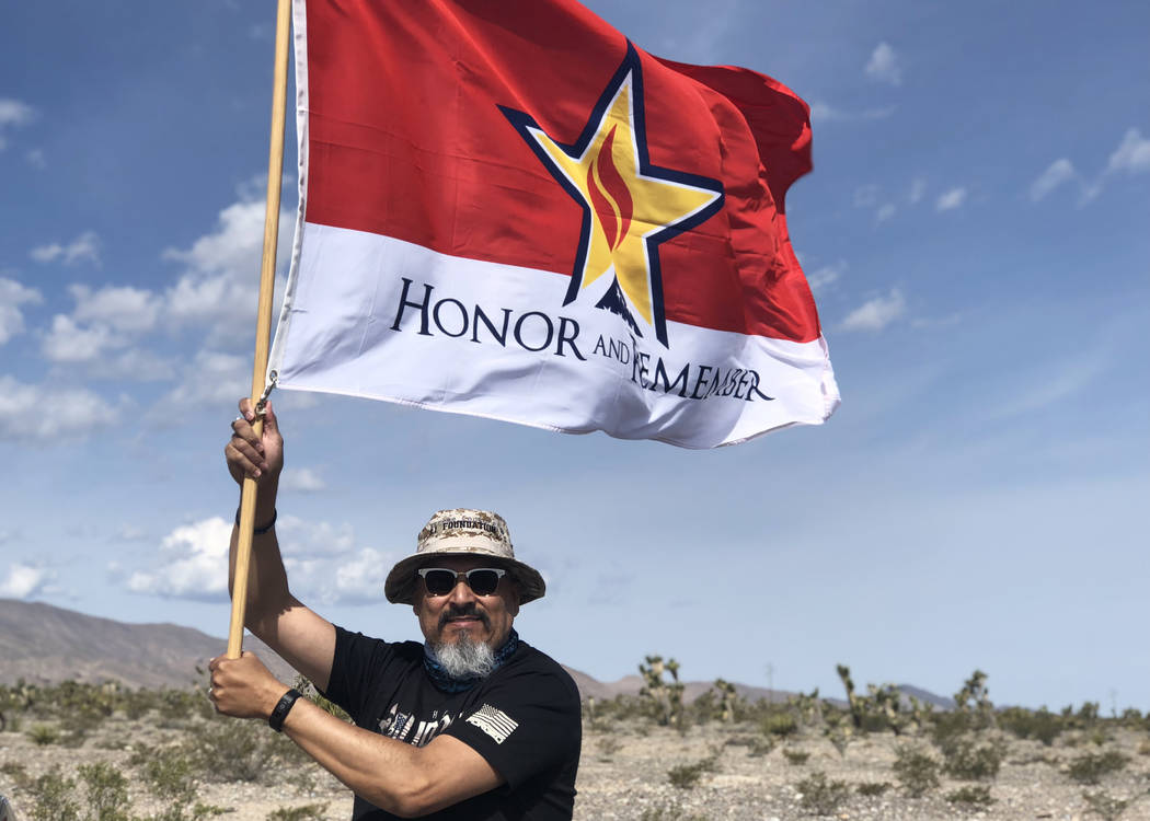 Air Force veteran Leo Garcia poses with his Gold Star flag during the first statewide Ruck March on Sunday, May 20, 2018. (Rio Lacanlale/Las Vegas Review-Journal)
