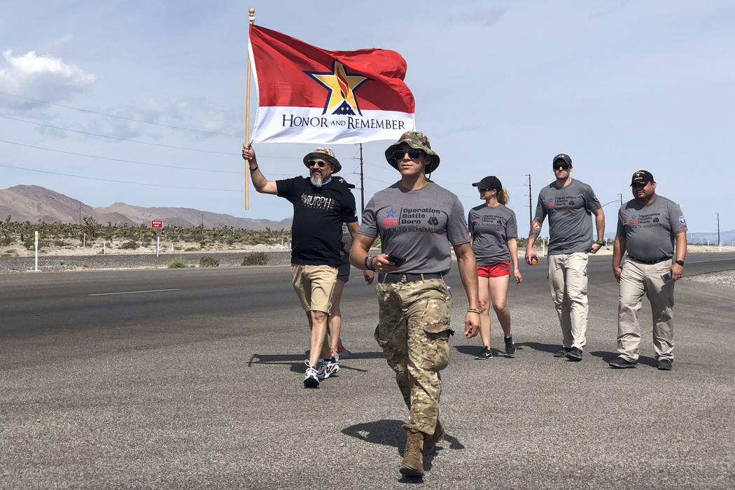 Nevada veterans and community members including Air Force veteran Leo Garcia holding his Gold Star flag, left, walk 370 miles with 7,000 dog tags in honor of fallen service members since 9/11. The ...