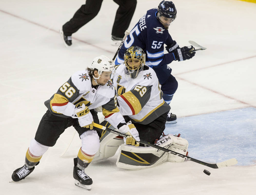 Golden Knights goaltender Marc-Andre Fleury (29) makes a save with the help of left wing Erik Haula (56) in the first period during game five of the NHL Western Conference Finals on Sunday, May ...