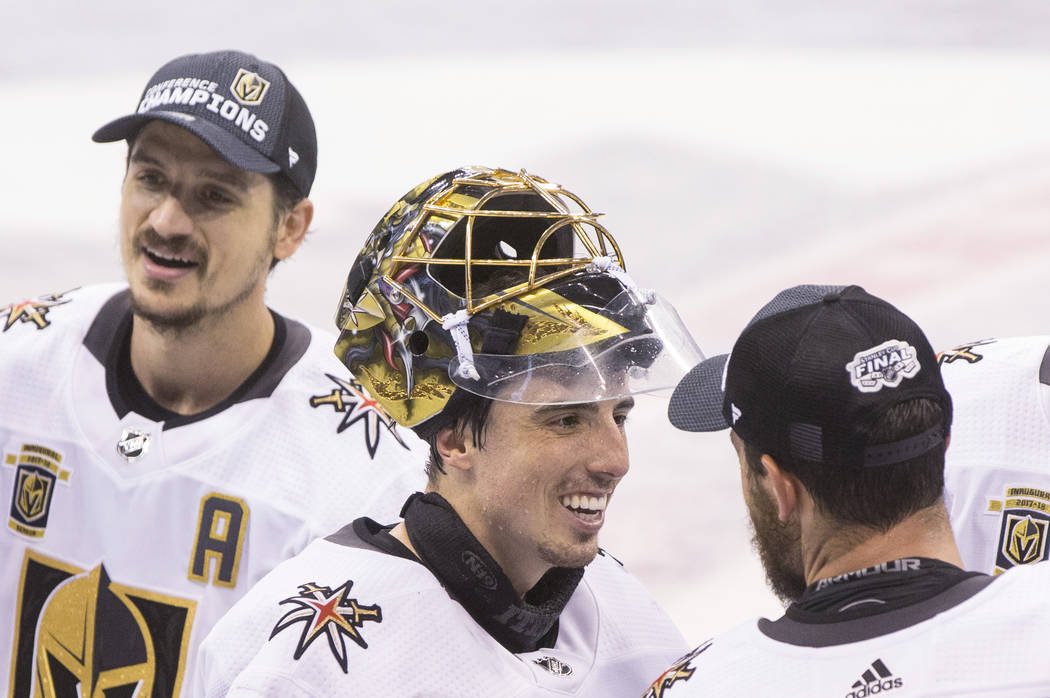 Golden Knights goaltender Marc-Andre Fleury (29) celebrates with teammates after Las Vegas beat the Winnipeg Jets 2-1 to advance to the Stanley Cup Finals on Sunday, May 20, 2018, at Bell MTS Plac ...