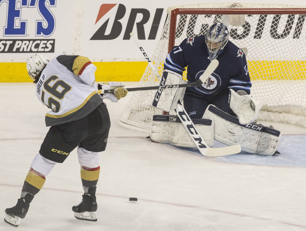 Golden Knights left wing Erik Haula (56) shoots on Jets goaltender Connor Hellebuyck (37) in the first period during game five of the NHL Western Conference Finals on Sunday, May 20, 2018, at Bell ...