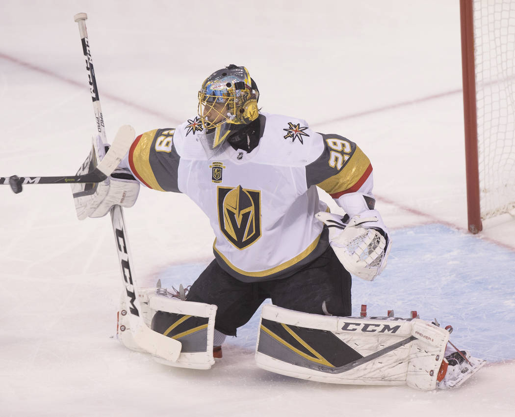 Golden Knights goaltender Marc-Andre Fleury (29) makes a save in the first period during game five of the NHL Western Conference Finals on Sunday, May 20, 2018, at Bell MTS Place, in Winnipeg, Can ...