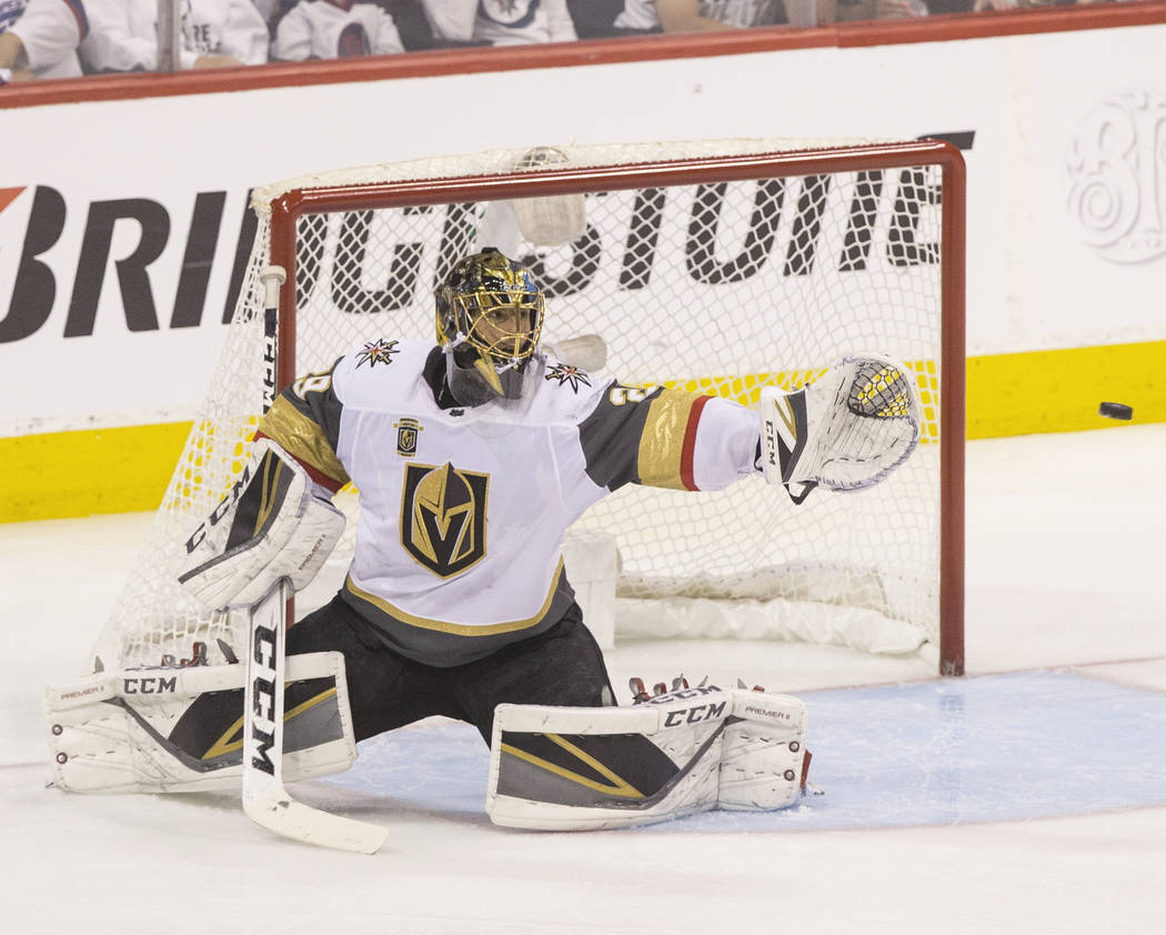 Golden Knights goaltender Marc-Andre Fleury (29) makes a save in the second period during game five of the NHL Western Conference Finals on Sunday, May 20, 2018, at Bell MTS Place, in Winnipeg, Ca ...