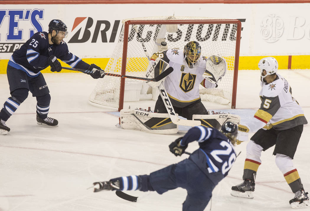 Golden Knights goaltender Marc-Andre Fleury (29) makes a save on Jets right wing Patrik Laine (29) in the second period during game five of the NHL Western Conference Finals on Sunday, May 20, 201 ...