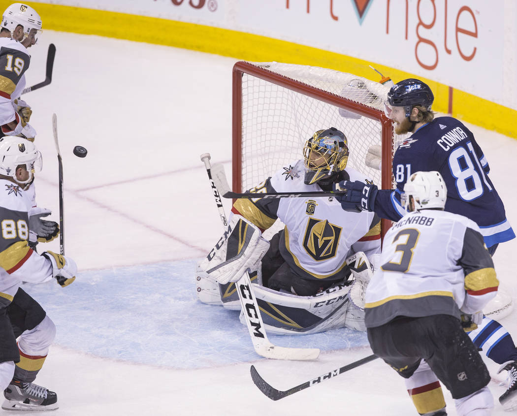 Golden Knights goaltender Marc-Andre Fleury (29) makes a save against Jets left wing Kyle Connor (81) in the third period during game five of the NHL Western Conference Finals on Sunday, May 20, 2 ...