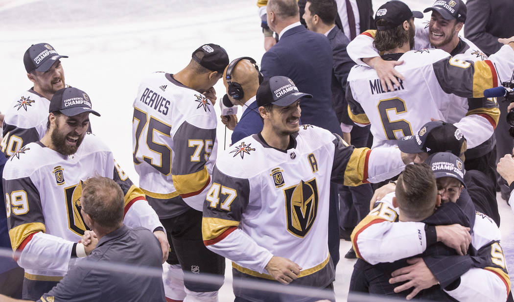 Golden Knights players and staff celebrate after beating the Winnipeg Jets 2-1 to advance to the Stanley Cup Finals on Sunday, May 20, 2018, at Bell MTS Place, in Winnipeg, Canada. Benjamin Hager ...