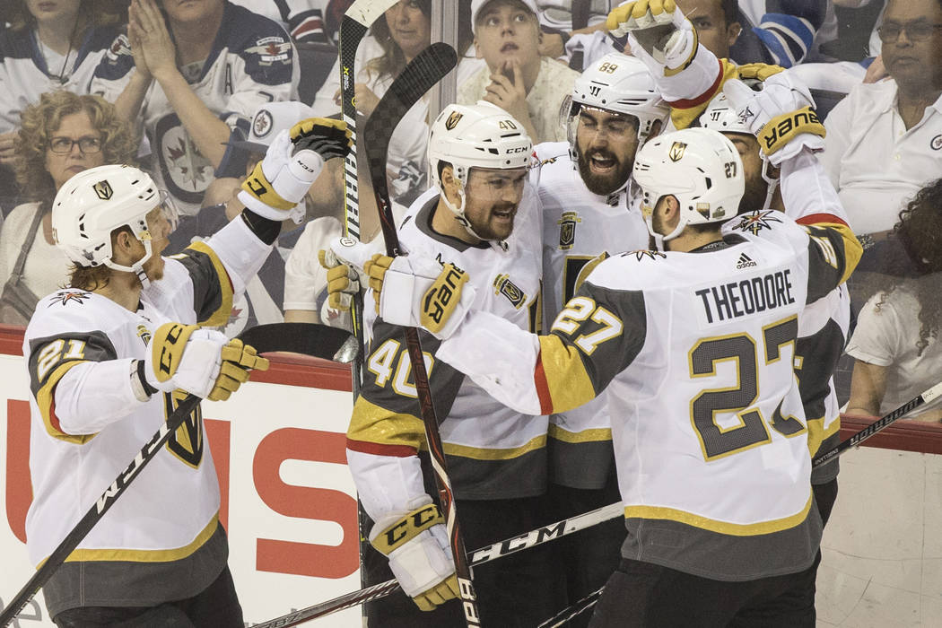 The Golden Knights celebrate after right wing Alex Tuch (89) scored a first period goal during game five of the NHL Western Conference Finals on Sunday, May 20, 2018, at Bell MTS Place, in Winnipe ...