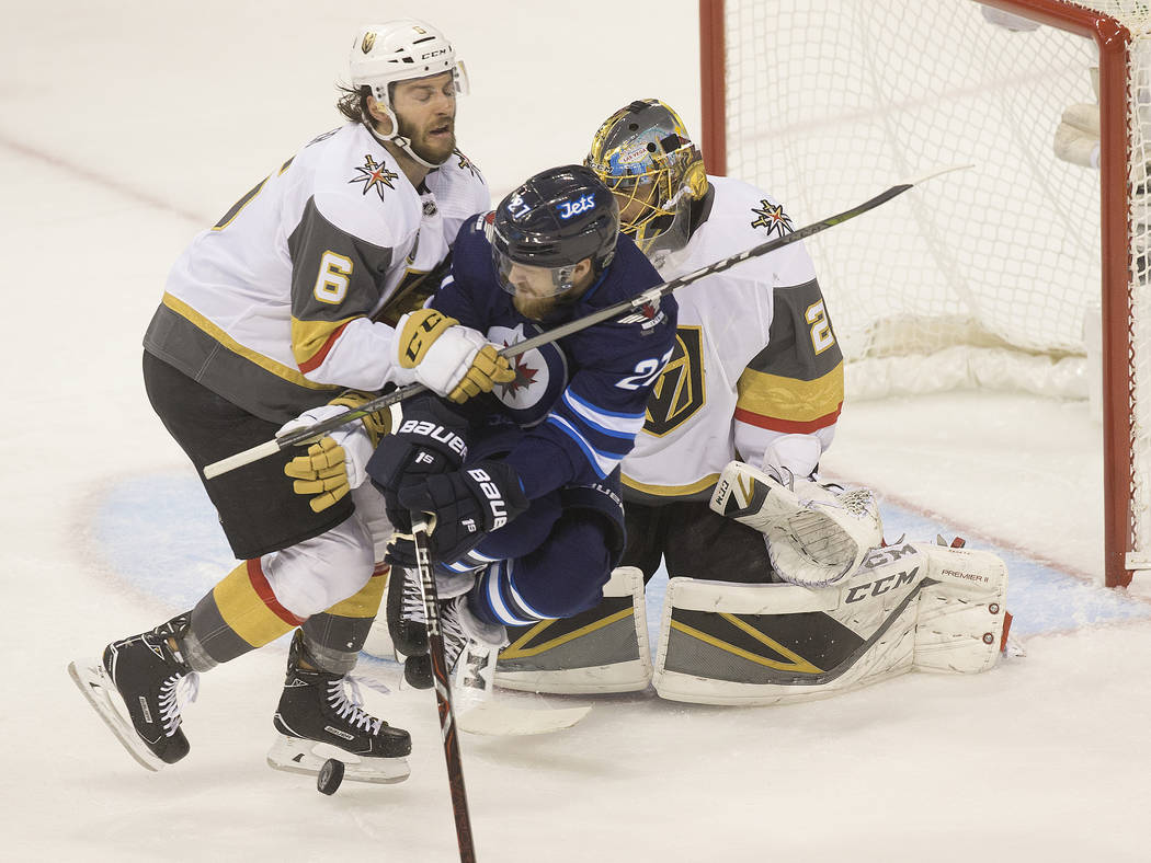 Golden Knights defenseman Colin Miller (6) collides with Jets left wing Nikolaj Ehlers (27) in the first period during game five of the NHL Western Conference Finals on Sunday, May 20, 2018, at Be ...
