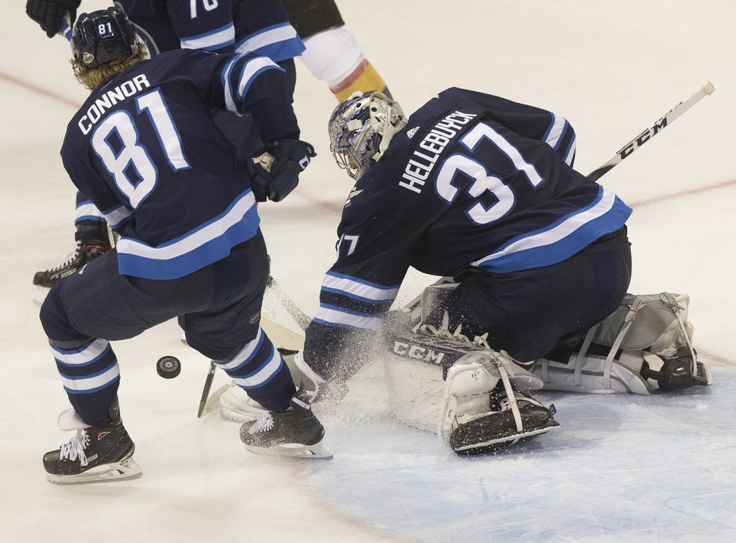 Jets goaltender Connor Hellebuyck (37) makes a save in the second period during game five of the NHL Western Conference Finals on Sunday, May 20, 2018, at Bell MTS Place, in Winnipeg, Canada. Benj ...