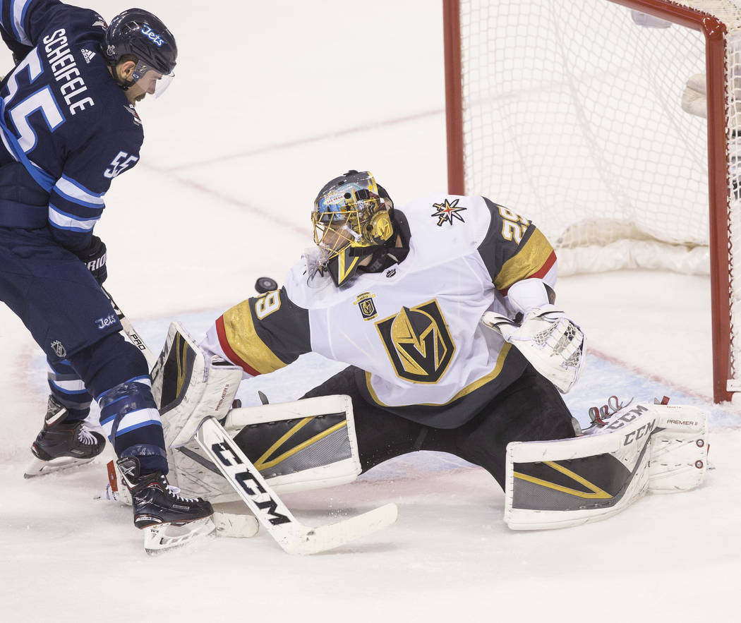 Golden Knights goaltender Marc-Andre Fleury (29) makes a save against Jets center Mark Scheifele (55) in the third period during game five of the NHL Western Conference Finals on Sunday, May 20, 2 ...