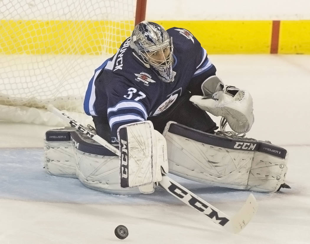 Jets goaltender Connor Hellebuyck (37) makes a save in the third period during game five of the NHL Western Conference Finals on Sunday, May 20, 2018, at Bell MTS Place, in Winnipeg, Canada. The G ...