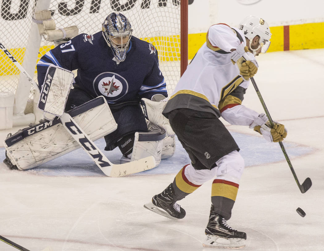 Jets goaltender Connor Hellebuyck (37) makes a save against Golden Knights right wing Reilly Smith (19) in the third period during game five of the NHL Western Conference Finals on Sunday, May 20, ...