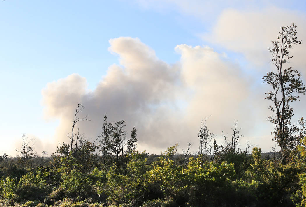 An ash plume rises from summit of Kilauea in Hawaii, on Monday, May 21, 2018. Although the affected area of the ongoing eruptions is small, some hotels have had cancellations for trips in June and ...