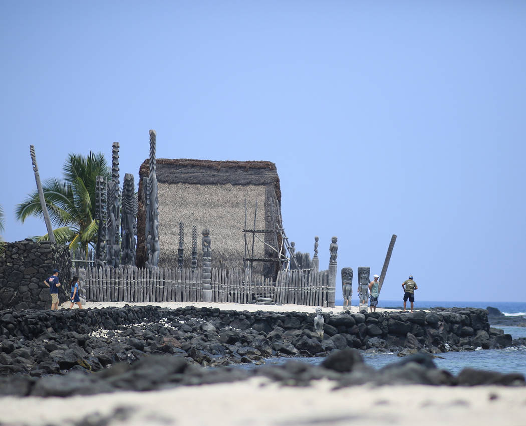 People take in sights at Pu'uhonua O Honaunau National Historical Park in Hawaii, on Monday, May 21, 2018. Although the affected area of the ongoing eruptions is small, some hotels have had cancel ...